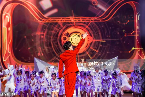 Singer Dimash Kudaibergen performs on the stage during 2017 Alibaba Singles' Day Global Shopping Festival gala at MercedesBenz Arena on November 10...