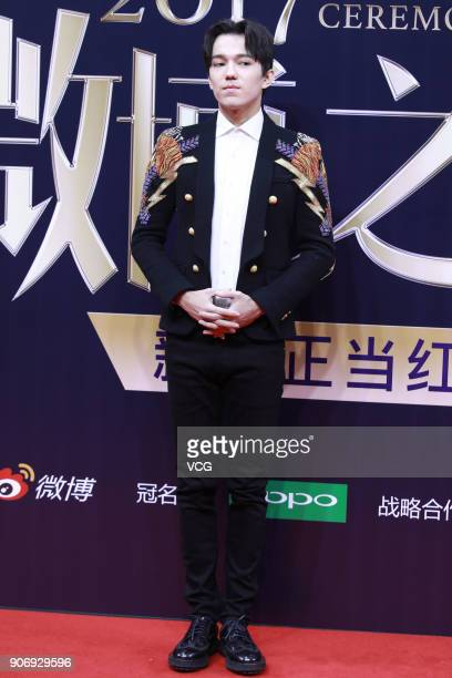 Singer Dimash Kudaibergen poses on the red carpet of 2017 Weibo Awards Ceremony at National Aquatics Center on January 18 2018 in Beijing China