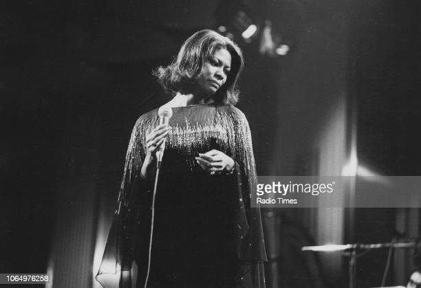 Singer Dionne Warwick performing at the Cunard International Hotel for the television show 'The Other Broadway' London July 18th 1975