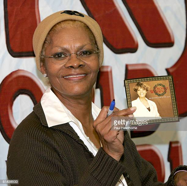 Singer Dionne Warwick signs copies of her first ever holiday CD My Favorite Time of the Year at JR Music World December 8 2004 in New York City