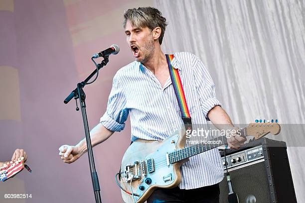 Singer Dirk von Lowtzow of the German band Tocotronic performs live on stage during the first day of Lollapalooza Festival at the Treptower Park on...