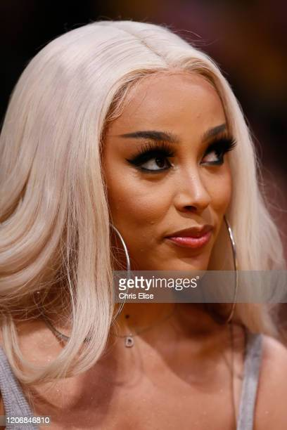 Singer Doja Cat looks on during a game at the Staples Center on March 10 2020 in Los Angeles CA NOTE TO USER User expressly acknowledges and agrees...