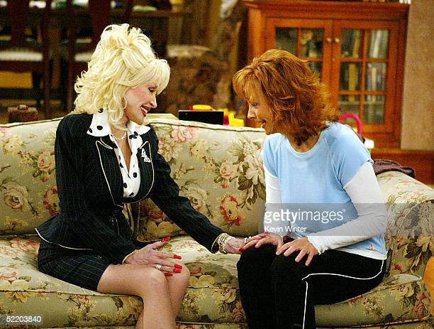 Singer Dolly Parton and actress/singer Reba McEntire appear on the set of The WB's Reba at 20th Century Fox Studios on February 15 2005 in Los...