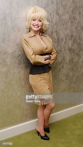 Singer Dolly Parton poses for a photograph prior to the Tennessee Film Music Commission's industry reception at the W Hotel on October 15 2002 in...