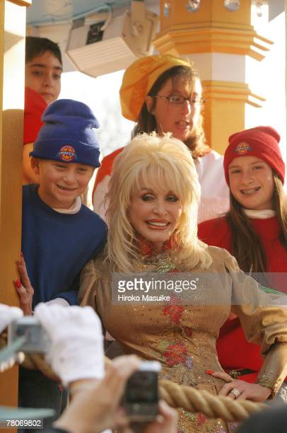 Singer Dolly Parton poses with parade participants during the 81st annual Macy's Thanksgiving Day Parade on November 22 in New York City
