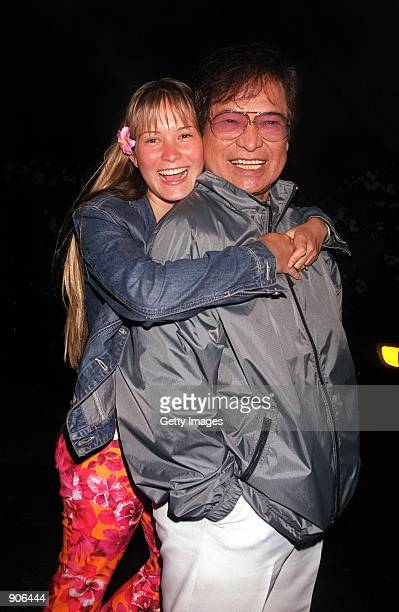 Singer Don Ho poses with his daughter Hoku September 4 2000 at a Hawaiian party in Beverly Hills CA