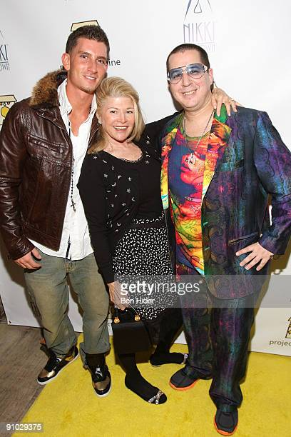 Singer Donnie Klang gallerist Michelle Rosenfeld and designer Noah G Pop attend Project Sunshine's John Legend performance at Nikki Beach on...