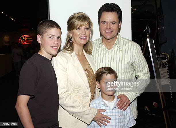 Singer Donny Osmond his wife Debbie and their sons Chris and Joshua arrive at the Golden Dads Awards ceremony at the Peterson Automotive Museum on...