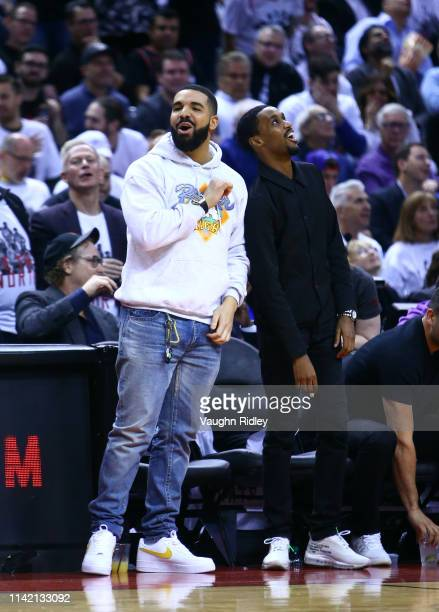 Singer Drake and Future the Prince cheer in the second half during Game Five of the second round of the 2019 NBA Playoffs between the Philadelphia...