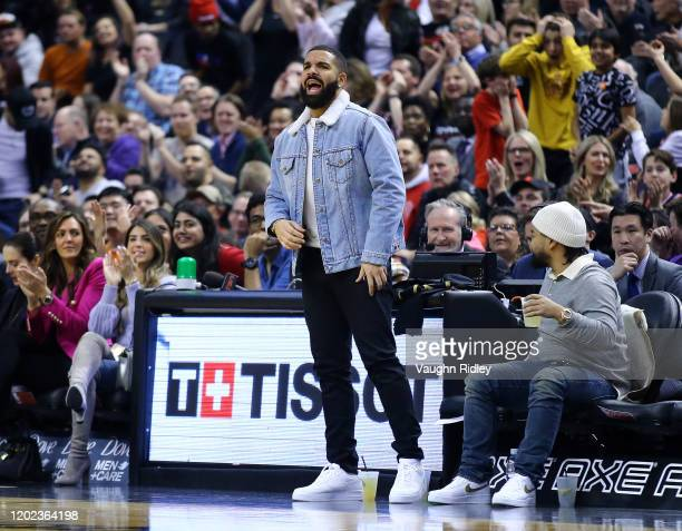 Singer Drake looks on from his court side seats during the first half of an NBA game between the Phoenix Suns and the Toronto Raptors at Scotiabank...