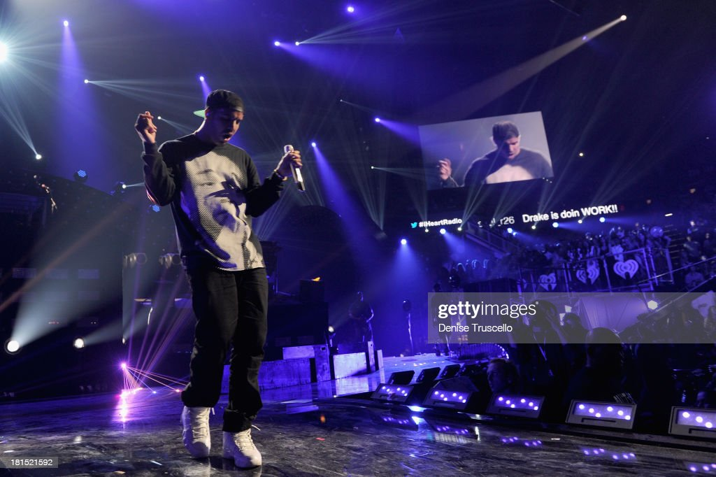 Singer Drake performs onstage during the iHeartRadio Music Festival at the MGM Grand Garden Arena on September 21, 2013 in Las Vegas, Nevada.