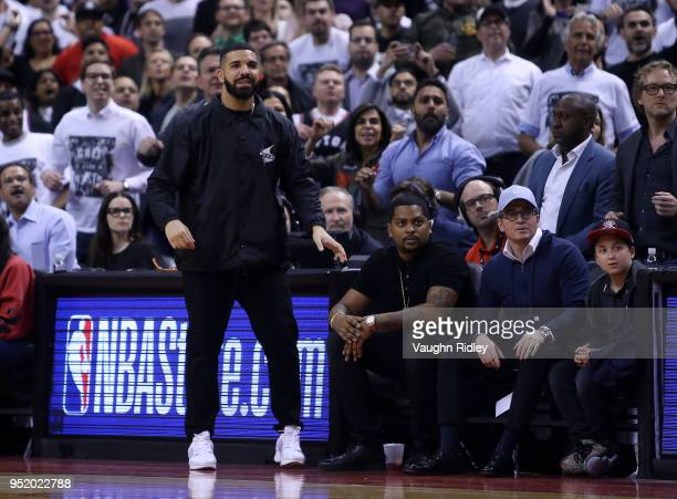 Singer Drake reacts from his courtside seat during the second half of Game Five between the Washington Wizards and the Toronto Raptors in Round One...