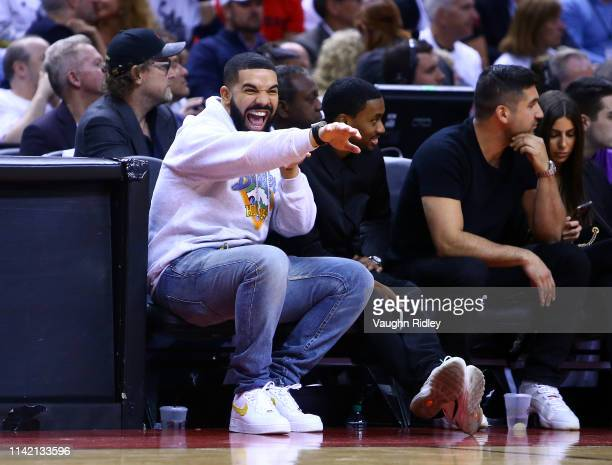 Singer Drake reacts in the second half during Game Five of the second round of the 2019 NBA Playoffs between the Philadelphia 76ers and the Toronto...