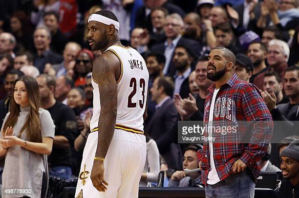 Singer Drake talks to LeBron James of the Cleveland Cavaliers during an NBA game between the Cleveland Cavaliers and the Toronto Raptors at the Air...