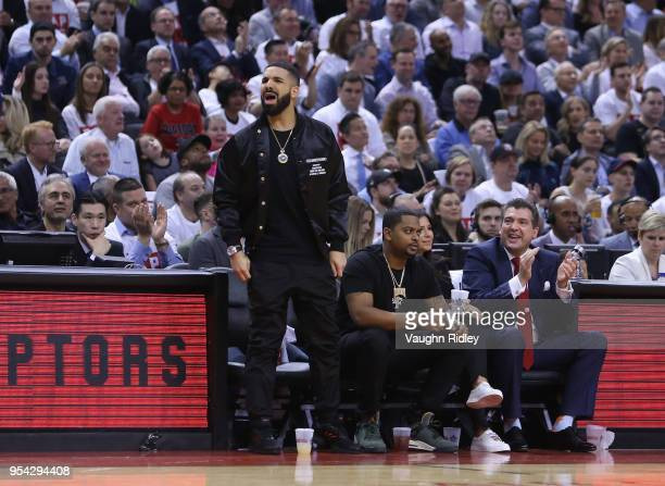 Singer Drake talks to LeBron James of the Cleveland Cavaliers from his court side seat in the first half of Game One of the Eastern Conference...