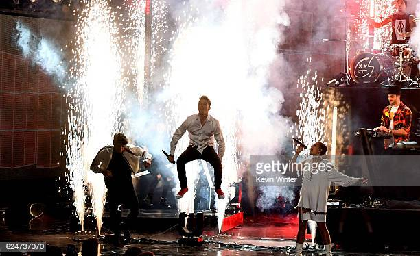 Singer Drew Taggart and musician Alex Pall of The Chainsmokers and singer Halsey perform onstage with musician Travis Barker during the 2016 American...