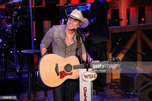 Singer Dustin Lynch performs at The Grand Ole Opry at Ryman Auditorium on November 11 2014 in Nashville Tennessee