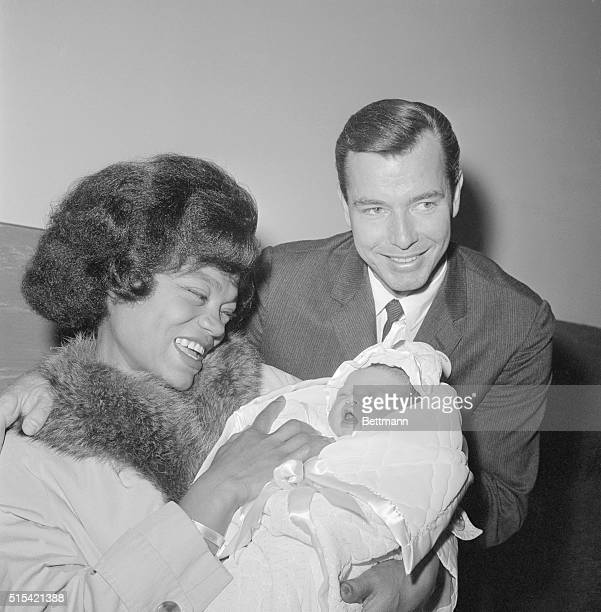 Singer Eartha Kitt and her husband real estate man William McDonald are all smiles as they debut their 4 day old baby girl as they left Cedars of...