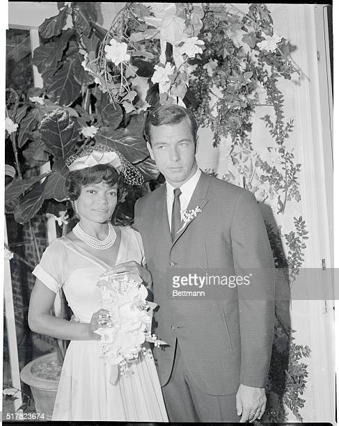Singer Eartha Kitt is shown with her husband William O McDonald whom she married at her home The bride wore an original Don Loper creation of a...