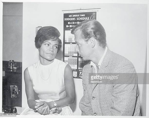 Singer Eartha Kitt sits at the Marriage License Bureau with her fiance Real Estate Investor William McDonald as they await the Issuance of a marriage...