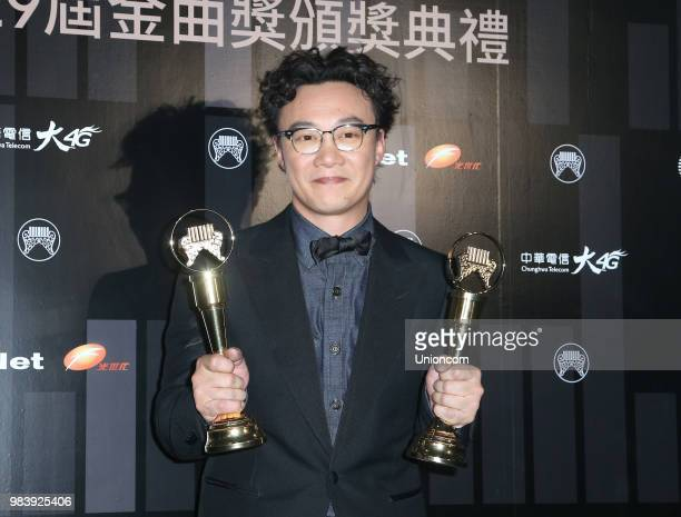 Singer Eason Chan poses with his trophies at backstage of the 29th Golden Melody Awards ceremony on June 23 2018 in Taipei Taiwan of China