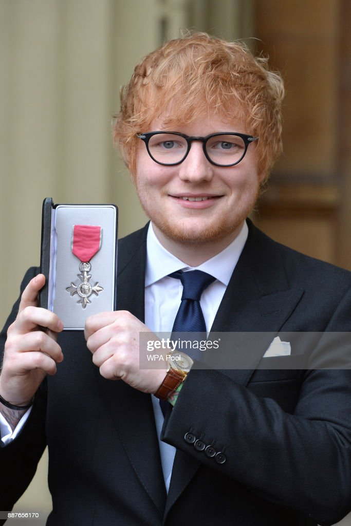 Singer Ed Sheeran poses with his MBE (Member of the Order of the British Empire) medal that was presented to him by the Prince of Wales during an Investiture ceremony on December 7, 2017 at Buckingham Palace, London.