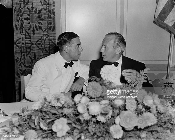 Singer Eddie Cantor talks with comedian Jack Benny during an event in Los Angeles California
