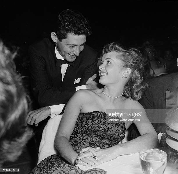 Singer Eddie Fisher talks with actress Debbie Reynolds between performances at the Cocoanut Grove in Los Angeles,CA.