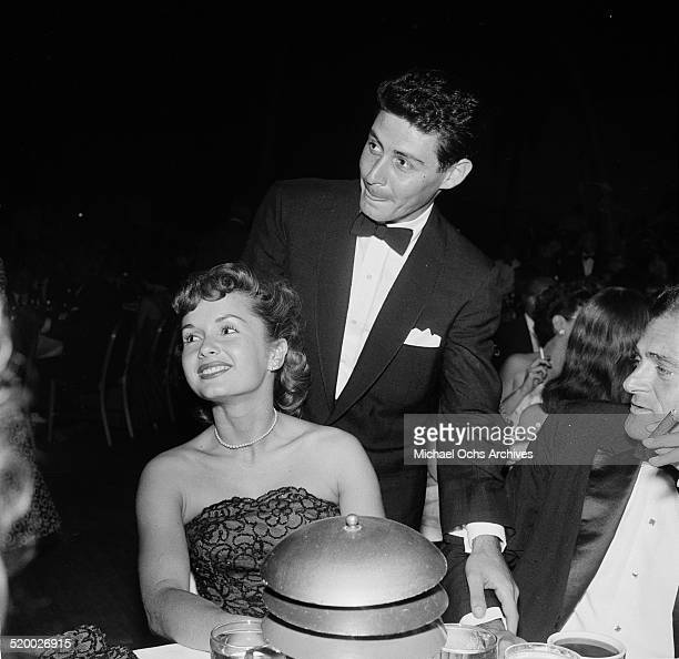 Singer Eddie Fisher talks with actress Debbie Reynolds between performances at the Cocoanut Grove in Los AngelesCA