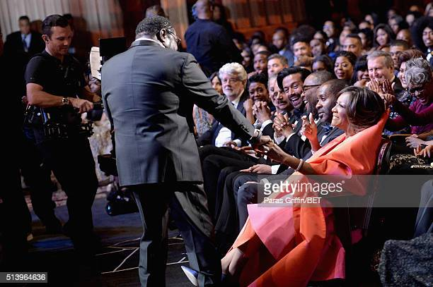 Singer Eddie Levert greets honoree Patti LeBelle at the BET Honors 2016 Show at Warner Theatre on March 5 2016 in Washington DC