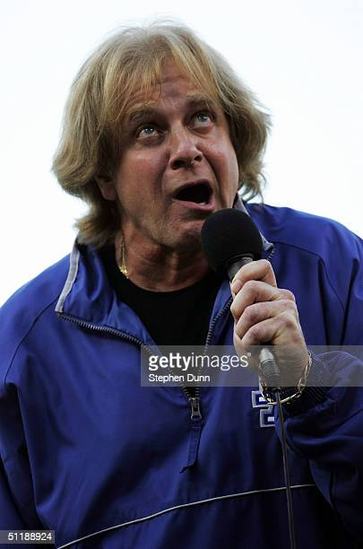 Singer Eddie Money sings the National Anthem prior to the game between the Los Angeles Dodgers and the Florida Marlins on August 18 2004 at Dodger...