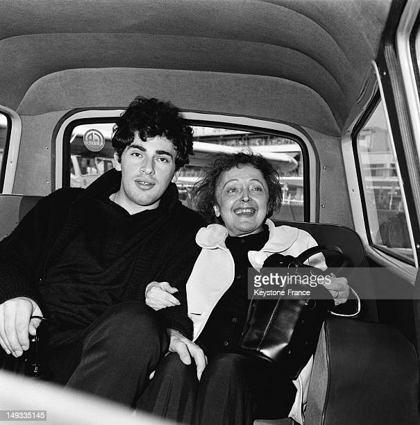 Singer Edith Piaf and her husband singer Theo Sarapo arrive at Nice airport for holiday in St Jean Cap Ferrat on May 31 1963 in Nice France