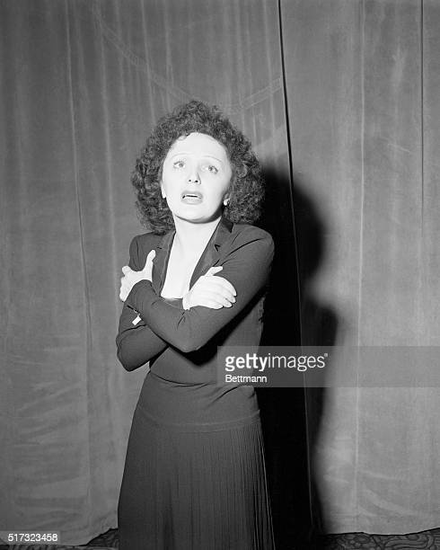 Singer Edith Piaf performs at the Versailles night club in New York City