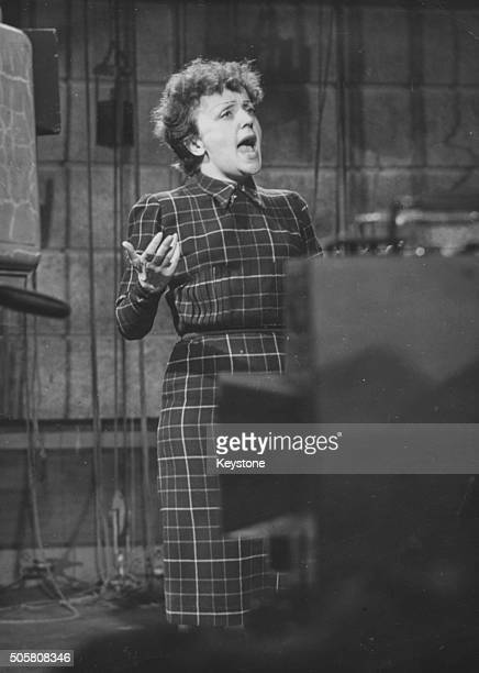 Singer Edith Piaf pictured singing in front of a camera behind the scenes of a television show January 19th 1951