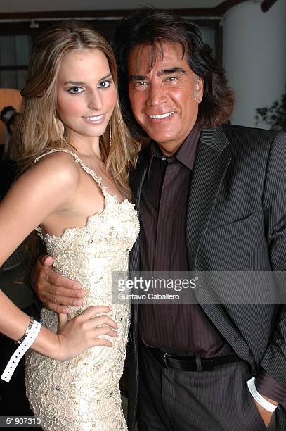 Singer El Puma and daughter actress Genesis Rodriguez at New Year's Eve party at the at the Delano Hotel on January 1 2005 in Miami Beach Florida