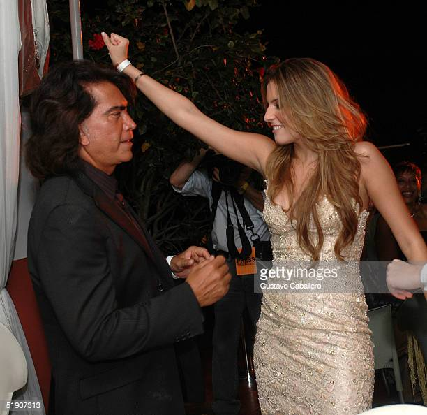 Singer El Puma and daughter actress Genesis Rodriguez dance at New Year's Eve party at the at the Delano Hotel on January 1 2005 in Miami Beach...
