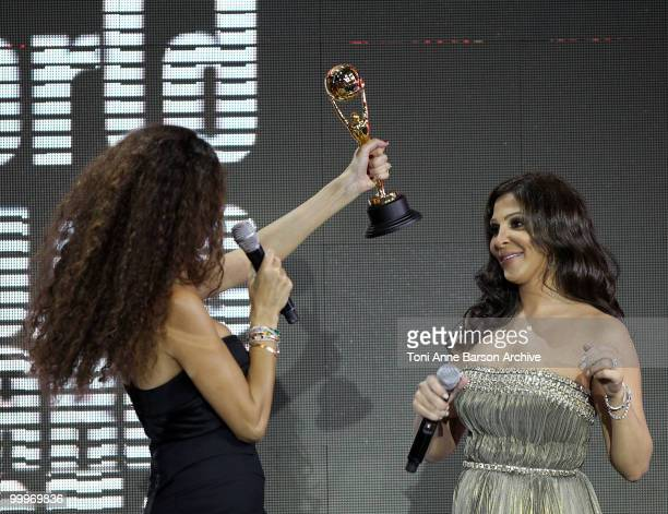 Singer Elissa receives World Music Award from Afef Jnifen on stage during the World Music Awards 2010 at the Sporting Club on May 18 2010 in Monte...