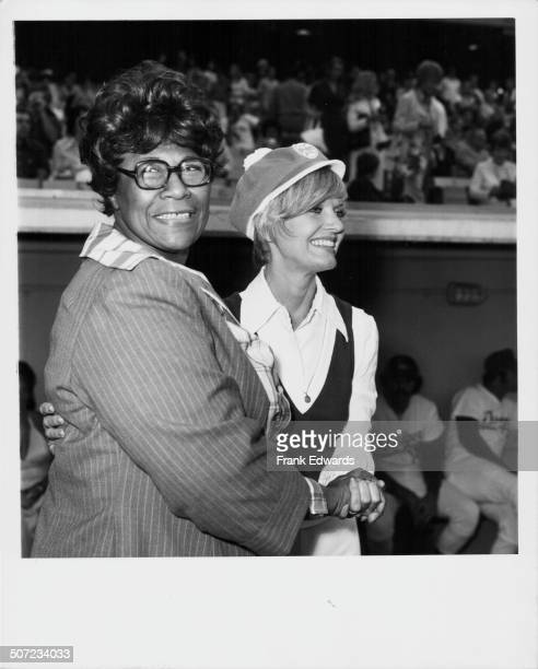 Singer Ella Fitzgerald cheering on her fellow celebrities during a charity baseball game with Florence Henderson August 1973