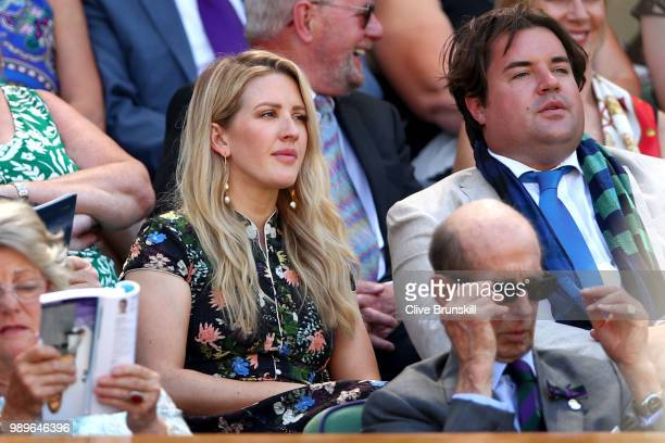 Singer Ellie Goulding watches the action from the stands in Centre Court on day one of the Wimbledon Lawn Tennis Championships at All England Lawn...