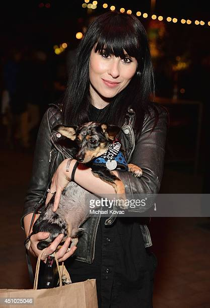 Singer Ellie Innocenti of musical group 'Deluka' enjoys the 'More Than a Cone' art auction and campaign launch benefiting Best Friends Animal Society...