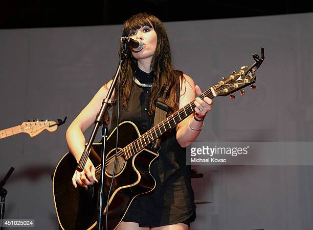 Singer Ellie Innocenti of musical group 'Deluka' performs onstage at the 'More Than a Cone' art auction and campaign launch benefiting Best Friends...
