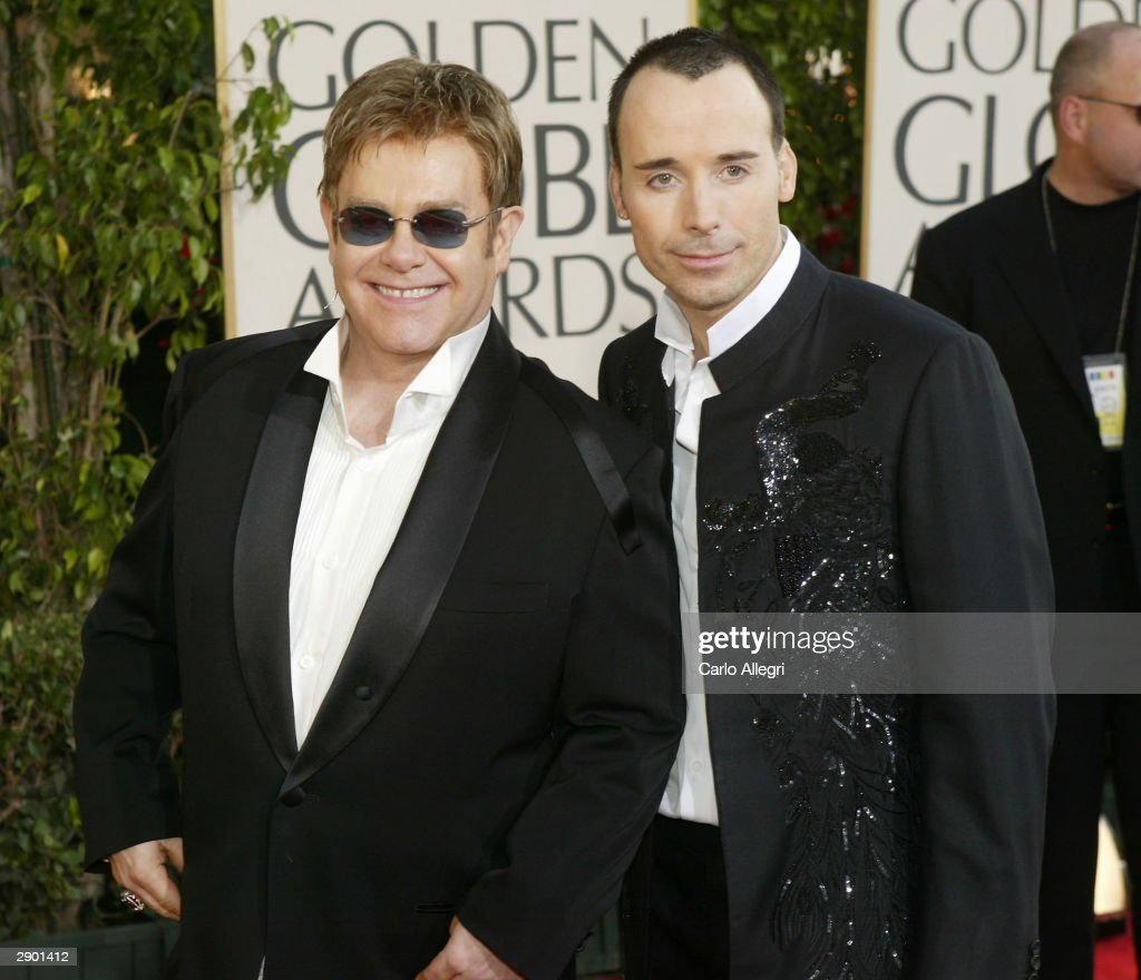 Singer Elton John (L) and Guest David Furnish attend the 61st Annual Golden Globe Awards at the Beverly Hilton Hotel on January 25, 2004 in Beverly Hills, California.