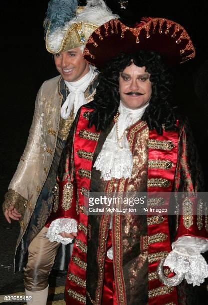 Singer Elton John and his partner David Furnish arrive at the pantomimethemed reception for the civil partnership between Matt Lucas and his longterm...
