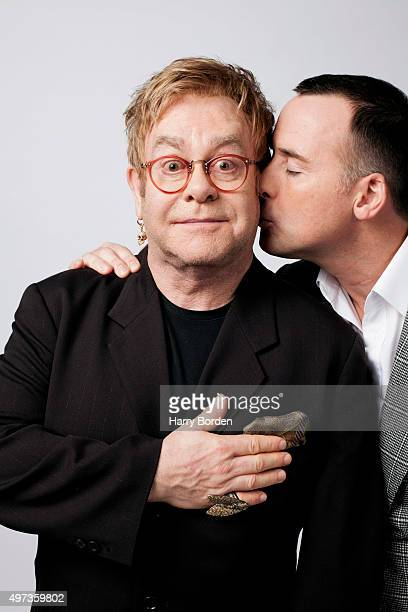 Singer Elton John and with his partner filmmaker David Furnish are photographed for the Sunday Times magazine on May 10, 2012 in London, England.