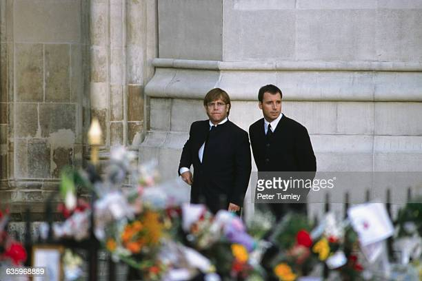Singer Elton John arrives with David Furnish at the funeral of Diana Princess of Wales only seven days after she was killed in an automobile accident...