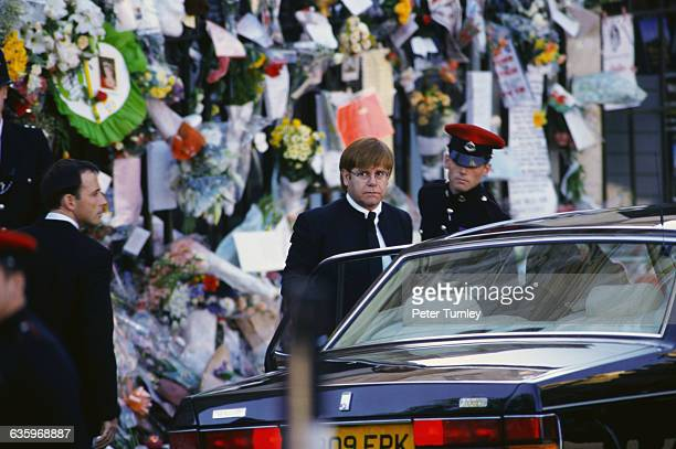 Singer Elton John gets into an automobile at the funeral of Diana Princess of Wales only seven days after she was killed in an automobile accident in...