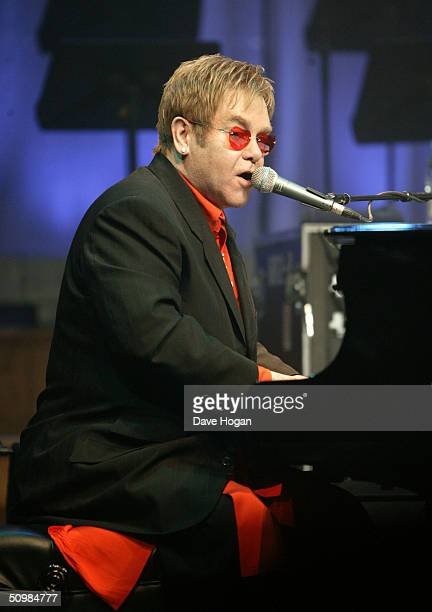 """Singer Elton John performs songs from """"Billy Elliott - The Musical"""" at the Royal Acedemy of Music on June 22, 2004 in London."""