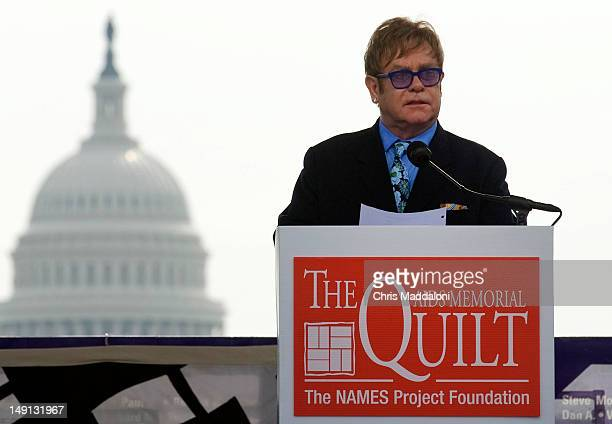 Singer Elton John reads aloud the names of people who dies of AIDS before visiting the AIDS Memorial Quilt on the Mall The 2012 International AIDS...