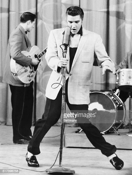 Singer Elvis Presley performing Hillbilly Heartbreak on stage in Hollywood, California.