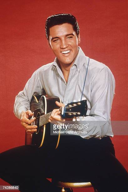 Singer Elvis Presley poses for a portrait with an acoustic for the release of his film It Happened At The World's Fair in September 1962 at MGM...